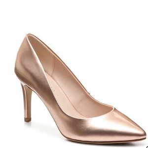 Gold pointed toe pumps